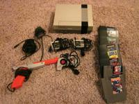 Original Nintendo NES system and video games. Consists