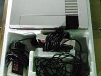 For sale is a working Nintendo NES that comes with the