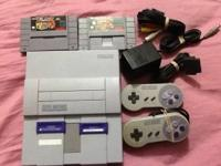 Super Nintendo with 2 controllers , 2 games and all the