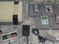 Up for sale is a Nintendo System with 5 Games and 2