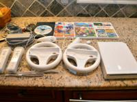 Nintendo Wii is in excellent condition.  Hardly used,
