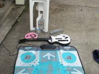 Wii system with tower, dance pad, guitar,4 controllers,
