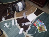 $150.00 Includes Wii console, carry bag, two remotes