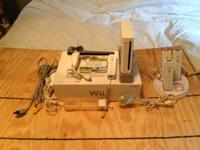 Selling a Nitendo Wii console with 4 rechargerable