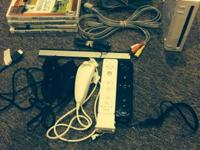 Nintendo Wii system with all cords, 2 motion plus