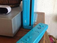 This is a used Nintendo Wii Turquiose blue Console Game