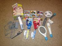 Nintendo Wii with 2 controllers, 2 nunchucks, 9 games,
