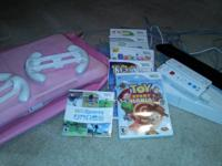Includes, 2 controllers, 5 games, 1 WII sports game