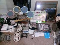 Wii with 4 remotes,1 hand held remote still sealed,