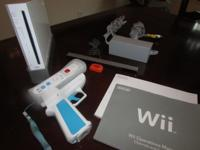 Nintendo Wii with 1 controller, gun, and manual Also