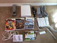 Nintendo Wii with 4 controllers, 2 of the controllers
