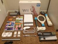 I'm selling my Nintendo Wii complete with 4 games (Wii