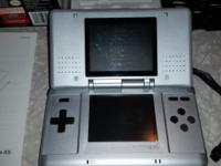 Silver Nintendo DS with original packaging, tested and