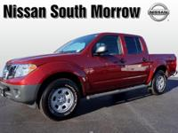 It's hard to resist this red 2013 Nissan Frontier S!