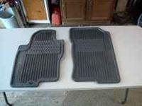 2008 Nissan Pathfinder allseason floor mats and cup