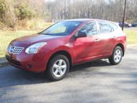 This outstanding example of a 2010 Nissan Rogue S is