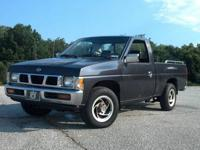 1996 Nissan Hard body truck. 4 cylinder, 5 speed, cold