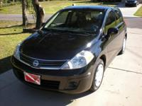 2012 Nissan Versa Hatchback S. 22,000 miles. The