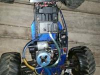 Nitro powered rc truck has 2 motors 3 carbs 4 brand new
