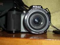Nixon digital camera with case. Uses 4 AA Batteries,