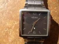 Nixon Watch with brand new battery. Stainless with