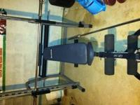Aluminum and stainless steel smith machine/squat rack.