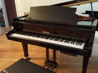 Beautiful baby grand piano, high gloss black, with