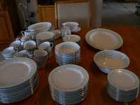 This is a full 12 place settings plus all the serving