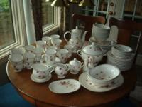 NORITAKE service for 12 plus many server pieces. Has