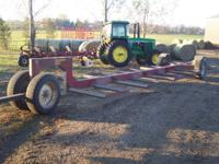 Notch bale mover for hauling round bales real good