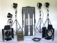 4 light setup with 1500D power pack. 3 Umbrellas, gels,