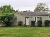 2 bedroom ranch slab with fenced yard and covered