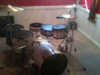 4 piece white drum set with pearl double bass peddle. 2