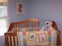 Oak baby bed (Sorelle) with mattress. The bed converts