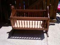 THIS ROCKING CRIB IS IN GREAT SHAPE...STURDY...CAN BE