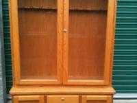 Custom oak cabinet with locking drawers and doors. Unit