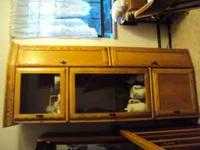Very nice oak cabinet with glass doors for sale. . Also