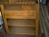 Custom oak changing table with large drawer and two