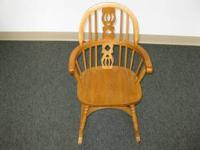 This is a solid oak childs rocking chair. It is new and