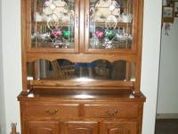 For sale is a two piece hutch. Medium Oak. No scratches