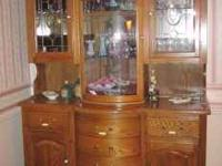 Tall Oak China Cabinet. Lots of storage space. Has many