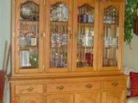 2 piece solid oak china cabinet. Top is leaded, beveled