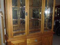 The hutch has etched glass on the front and the same