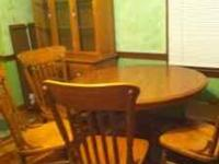 Lighted oak china hutch with pedestal table with two