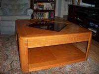 Large oak coffee table with center glass instert on