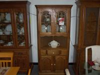 This is a preowned oak corner cabinet in excellent