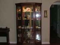Oak curio cabinet with mirrored back and mirrored