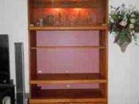 Oak curio cabinet can be used as a TV/ entertainment