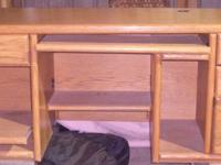 Large Solid Oak Desk Has pull outs for keyboard and