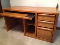 Oak computer desk, good condition. Desk is 55 1/2